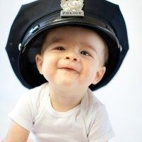This Kid will be a policeman one day!
