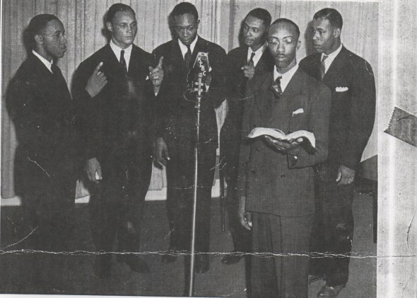 E.M. Franklin leads the Paramount Singers circa 1938. Younger brother A.C. Franklin is far left.