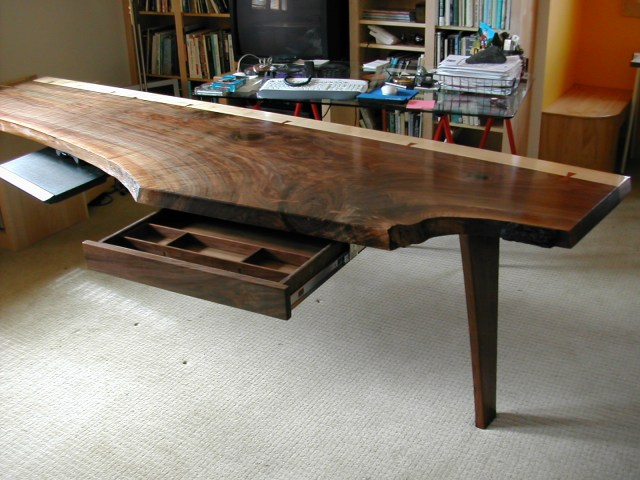 Walnut slab desk with pull-out and drawer