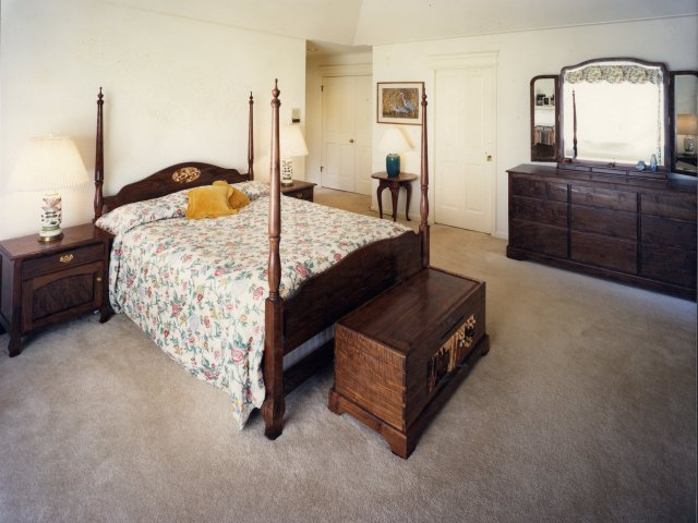 Traditional Queen Anne style bedroom set in western walnut