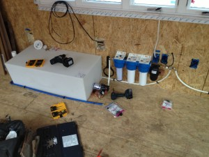 Rainwater tank and filtration system going in