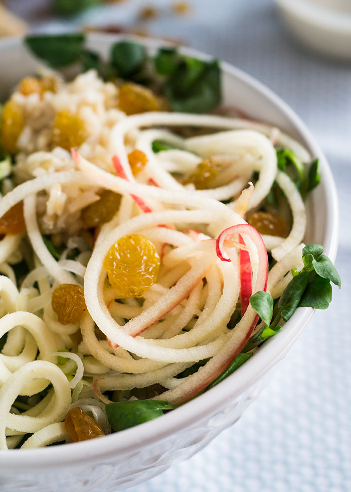 Spiralized Apple and Parsnip Power Bowls make a vegan, gluten free lunch packed with plant protein and topped with a killer Sumac Tahini Dressing.