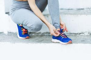 attractive-sportswoman-tying-shoelace-getting-ready-fitness-young-woman-runner-tying-shoelaces-copy-space-healthy-97144906