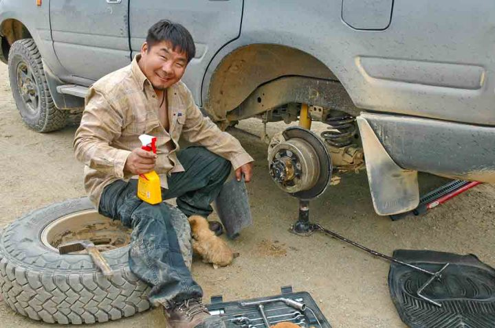 Repairing Landcruiser wheel assembly in Mongolia.