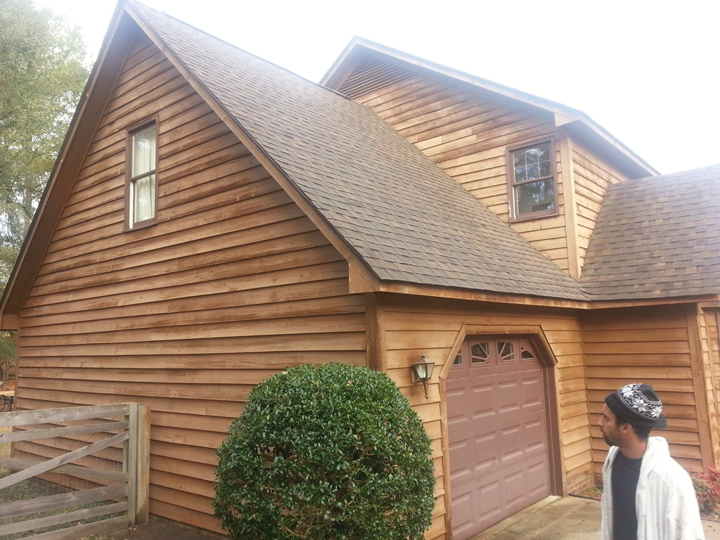 Here is another cedar house that we stained
