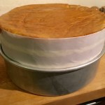 Parchment paper collar extends the height to accommodate four layers of cake and three layers of filling
