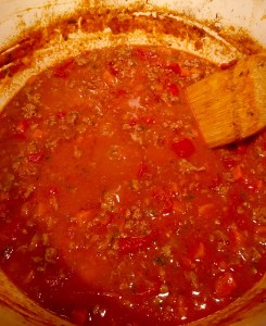 Simmer on low for 1-1/2 hours, remove the basil, then stir in grated cheese.