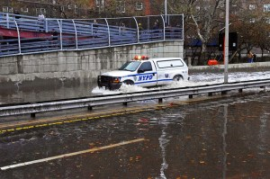 NYPD truck driving down the flooded FDR Drive during Hurricane Sandy, Source: Flickr Creative Commons, (C) david_shankbone