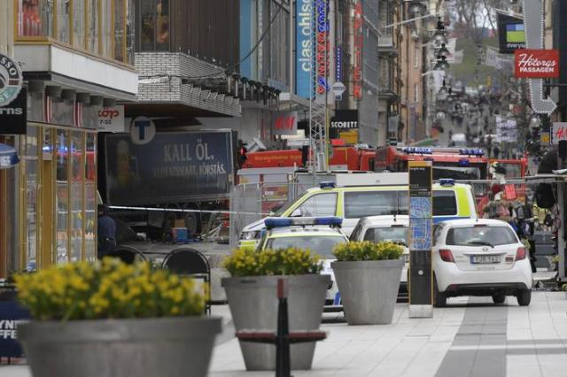 epa05894623 Swedish police and emergency services gather at the site where a truck reportedly crashed into a department store in central Stockholm, Sweden, 07 April 2017. A truck has driven into a department store on Drottninggatan street (Queen Street) in central Stockholm, media reported quoting local police. According to initial reports, at least three people were killed and others were injured in the incident, media added.  EPA/ANDERS WIKLUND  SWEDEN OUT