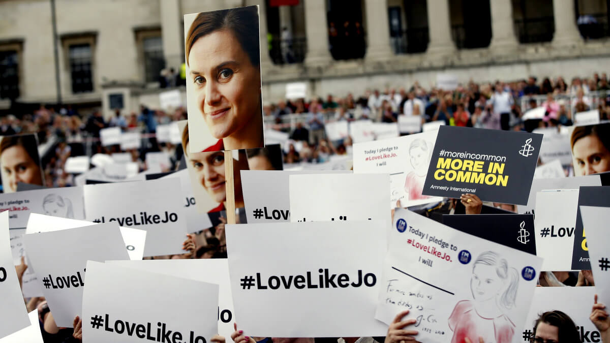 People hold signs during a Jo Cox memorial in Trafalgar Square, London, June 22, 2016. Alastair Grant | AP