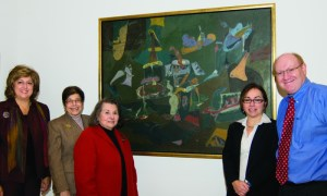 "Standing, from left, Nancy Hovnanian, Alma Alabilikian, Joan Momjian, Alice Beamesderfer and Michael Taylor in front of Gorky's ""Dark Green Painting"""