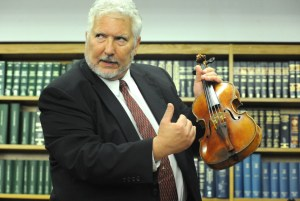 Master violin maker Phillip Injeian, describes to the press how he knew that this violin was in fact Roman Totenberg's 1734 Stradivarius violin, during a press conference at the U.S Attorney's Office on Thursday Aug. 6th, 2015, to which had been stolen from him since 1980.    Photo by Kristy Leibowitz
