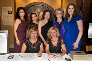 Event Chair, Nicole Babikian Hajjar, center, standing, and committee members, seated left to right: Vartus Varadian, Rita Bejakian; standing, left to right: Lorky Libaridian, Lalig Musserian, Ruth Thomasian, and Tsoleen Sarian. Photo by Winslow Martin.