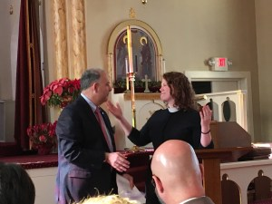 Reverend Laura Everett, Executive Director of the Massachusetts Council of Churches, congratulates Anthony Barsamian at the latter's inauguration as the council's president