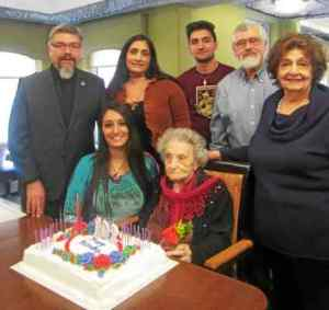Ramela Carman's family and friends honor her on her 102nd birthday Thursday: Father Aren Jebejian, (left) great-niece Tamara Doyon, niece Lydia Doyon, great-nephew Kyle Doyon, sister-in-law Rosemary Carman and Deacon Onnig Boyajian.