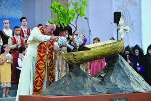 Pope Francis and Catholicos of All Armenians Karekin II water a tree planted in a replica of Noah's Ark, created by Michael Aram