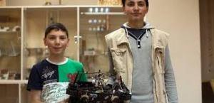 Rafael and Sahak Sahakyan with their robot.