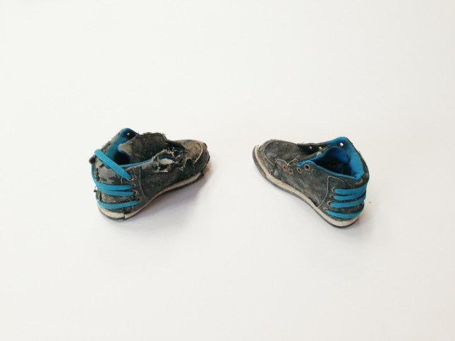 Guillermo Galindo. Micro Orchestra, 2014. Found child's tennis shoes. Dimensions variable. Courtesy of the artist.