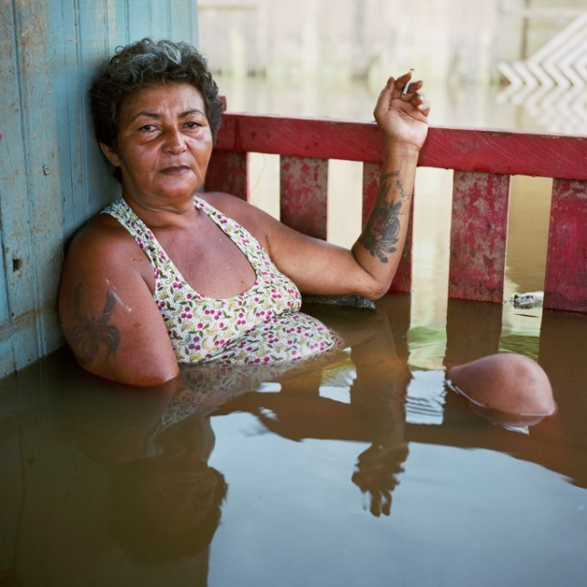 hoto: Francisca Chagas dos Santos, Taquari District, Rio Branco, Brazil, March 2015. From Submerged Portraits Series from Drowning World by Gideon Mendel.