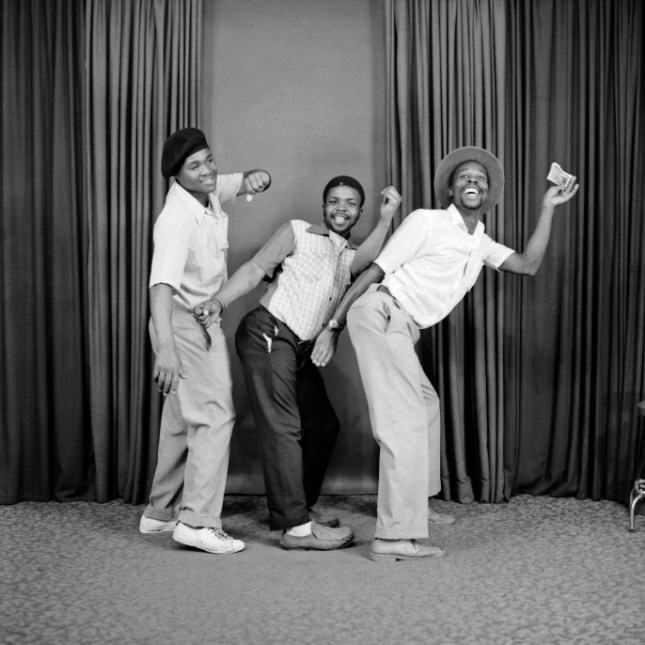 S. J. Moodley, [Three men dancing in a line], 1975 Read more at http://www.craveonline.com/art/996071-secret-histories-real-south-africa-seen-man-called-kitty#TEp93rt5prHJ3TQa.99. Courtesy The Walther Collection.