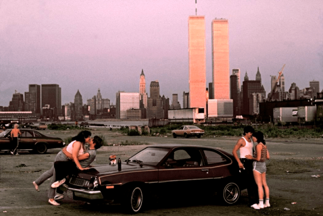 "Downtown Manhattan with World Trade Center towers, seen from ""lover's lane"" in New Jersey, 1983 by Thomas Hoepker."