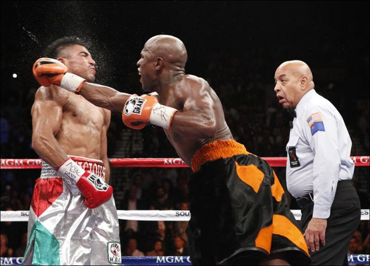 Floyd Mayweather Jr. mand a Ortiz a casa con los guantes abajo