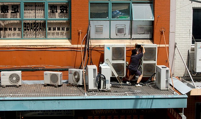 A man installing the HVAC