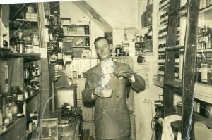 Madeline's grandfather Moise Silver standing in Loran's Drug Store.