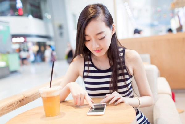 girl drinking a glass of iced drinks