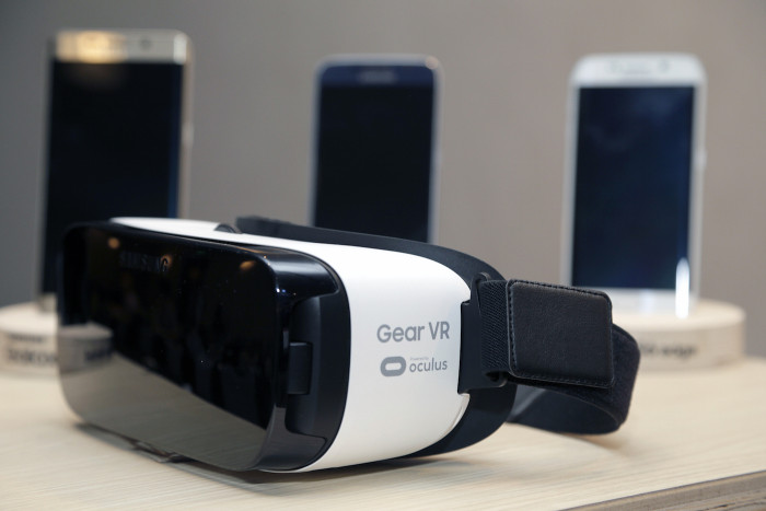 The Samsung Gear VR on display during the Oculus 2 conference in Los Angeles, Thursday, Sept. 24, 2015. Samsung says the new virtual reality headset will be 22 percent lighter and, at $99, half the price of its previous model. The Korean electronics company hopes the changes to the Gear VR, which ships in November, will help push virtual reality into the mainstream. (AP Photo/Nick Ut)