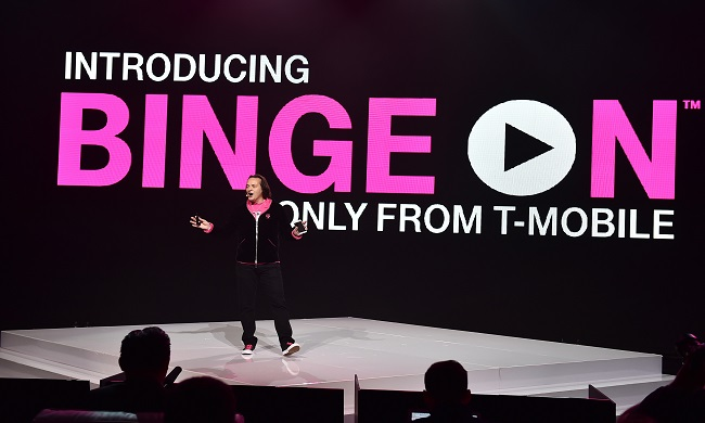 IMAGE DISTRIBUTED FOR T-MOBILE - T-Mobile CEO John Legere introduces Binge On during the Un-carrier X press conference at the Shrine Auditorium on Tuesday, Nov. 10, 2015, in Los Angeles. Binge On allows T-Mobile customers to stream video for free without using their LTE data. (Photo by Jordan Strauss/AP Images for T-Mobile)