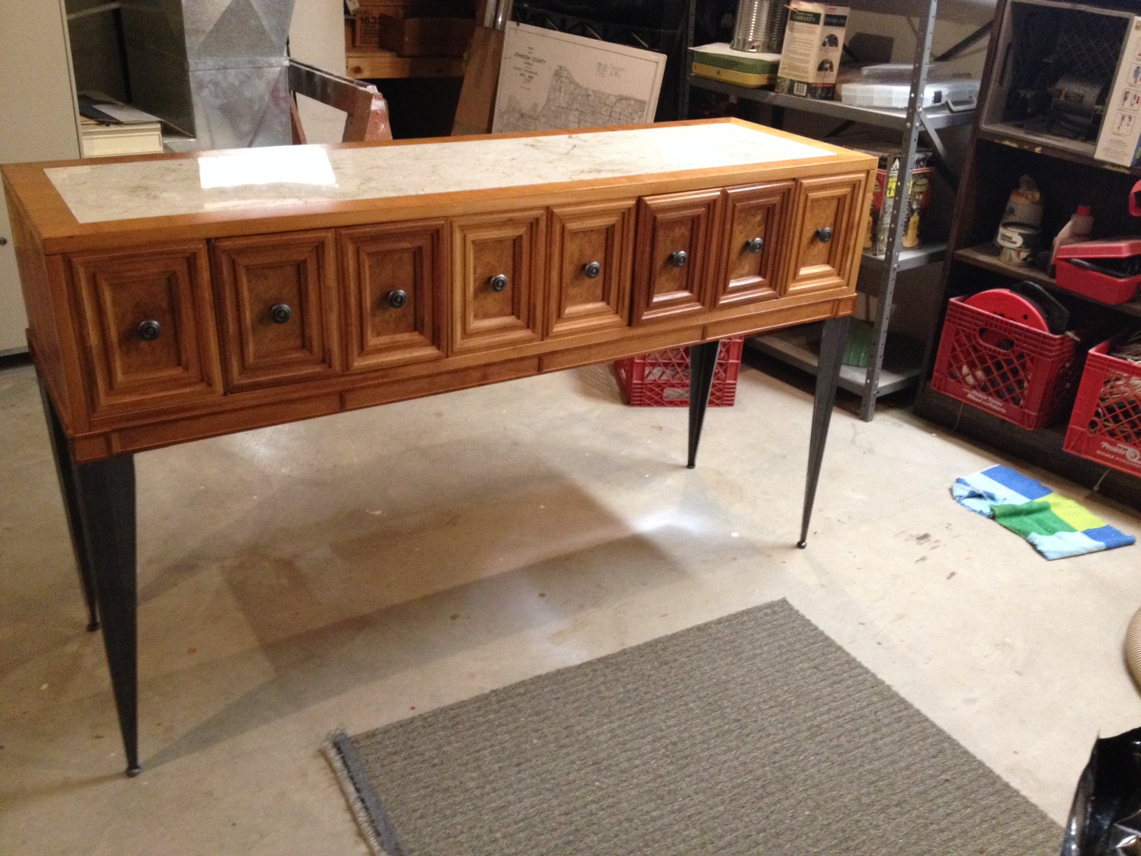 Marble top entryway table with tapered angle iron legs