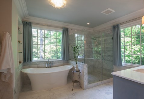 Master bathroom with bright windows