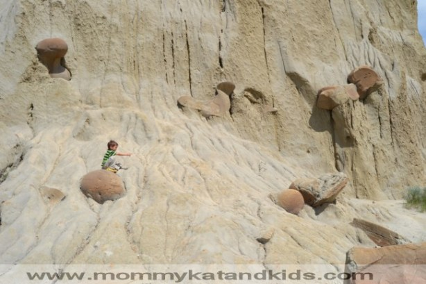 boy on rocks in north dakota badlands