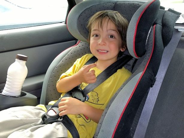 boy in evenflo securekid dlx car seat