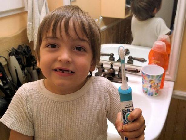 benjamin with sonicare for kids brush