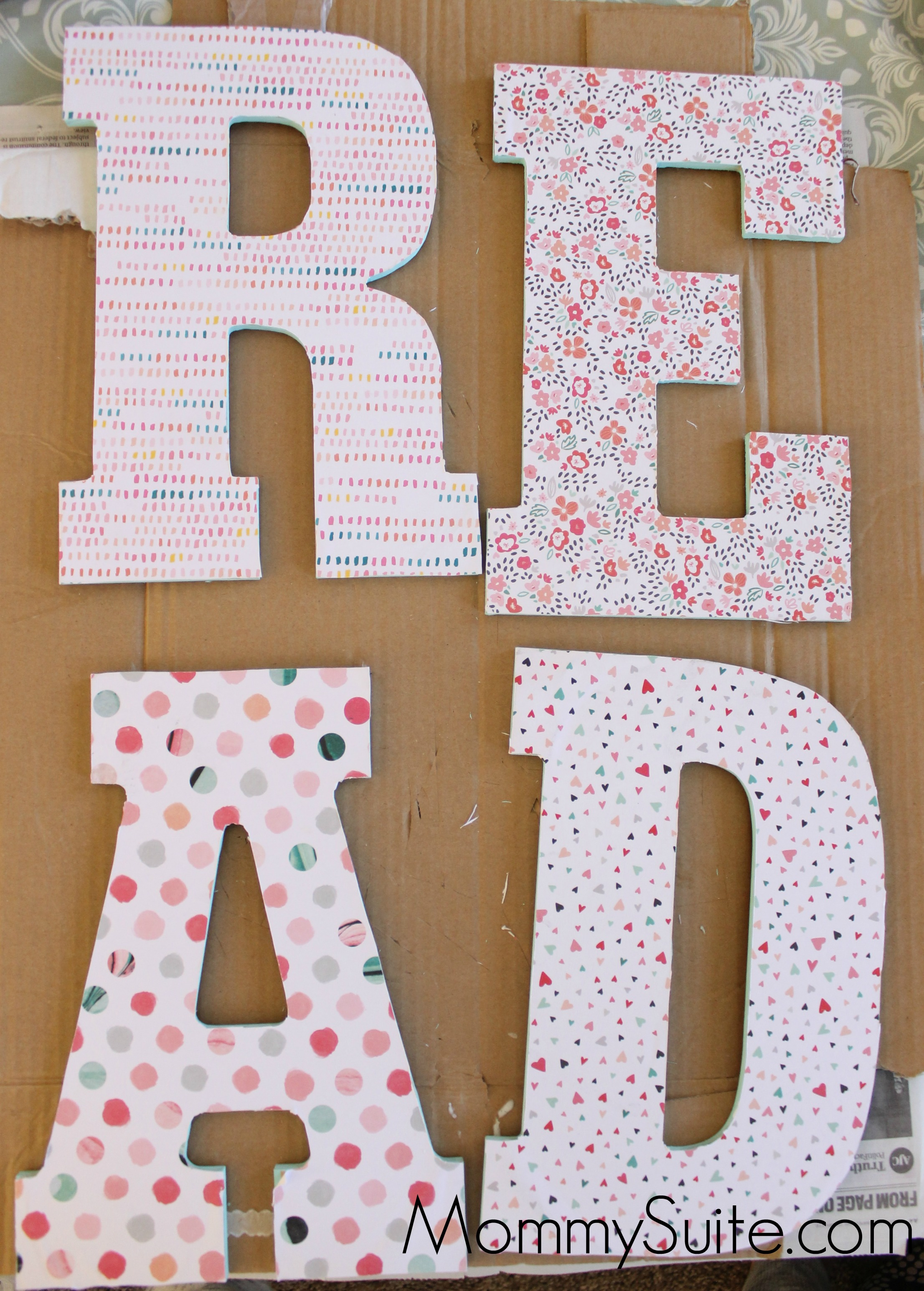 place a piece of cardboard underneath your letter to ensure a clean cut and to protect your surface decoupage letters