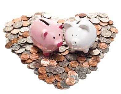 Boy and Girl Piggy Banks on Coin Heart