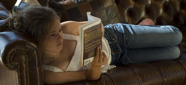 girl on leather couch reading