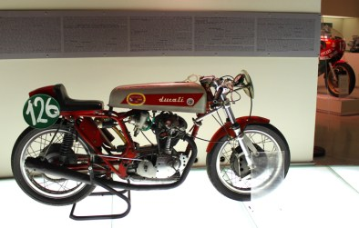 This is one well raced classic Ducati - check out the bike in back ground...