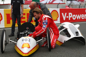Nick-Heidfeld-is-shown-a-Shell-Eco-marathon-vehicle-ahead-of-driving-it-on-track-at-Le-Mans-24-Hours