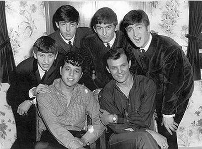 The Beatles (standing), Chris Montez (seated, l), Tommy Roe (seated, r), Mr. Media Interviews