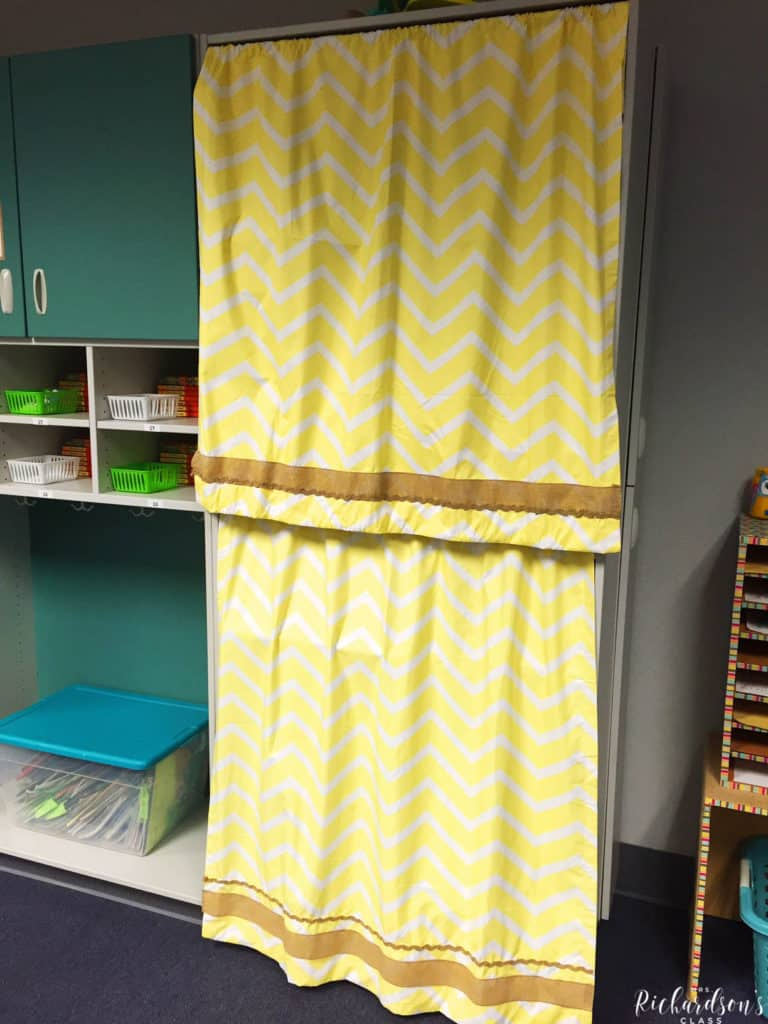 These hello curtains are trimmed with burlap and hide teacher supplies perfectly!