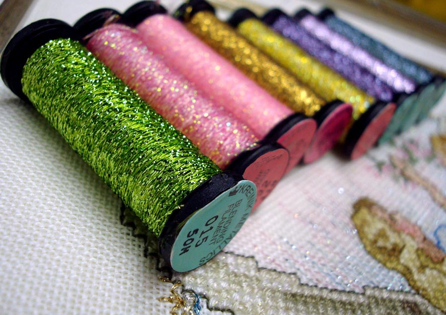 Metallic threads add light and color to needlework designs. Use them like a spice in cooking—to add interest, a little zip, to keep your design from being bland.