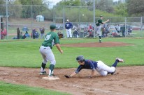 UM #4, Nate Brown safe at 1st.  Democrat photo by Pat Dollins