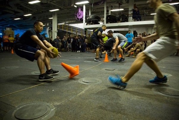 U.S. Marines and Sailors participate in a dodge ball tournament while sailing aboard USS ESSEX  | Photo public domain