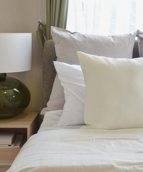 White cushions on a bed