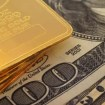 Gold-bars-on-100-and-50-dollar-bill