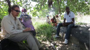Dr. Wilson (Board member), and Mai Jabu, Muonde Trust staff person (second from left), and participants at a typical seminar under a muonde tree (Ficus sur) in Madyakuseni area, 2013