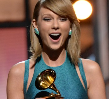LOS ANGELES, CA - FEBRUARY 08:  Taylor Swift presents award onstage during The 57th Annual GRAMMY Awards at the STAPLES Center on February 8, 2015 in Los Angeles, California.  (Photo by Kevin Mazur/WireImage)